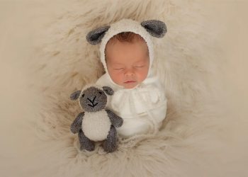 Newborn baby being photographed by New Born Photographer Moss & Ivy Photography.