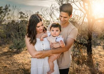 Young family outside being photographed by family photographer Moss & Ivy Photography | Geelong, Torquay, Jan Juc, Lara.